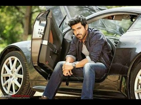 Indian film actor Ramcharan sitting on car seat with open door