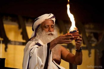 Jagadeesh Vasudev carrying fire lamp